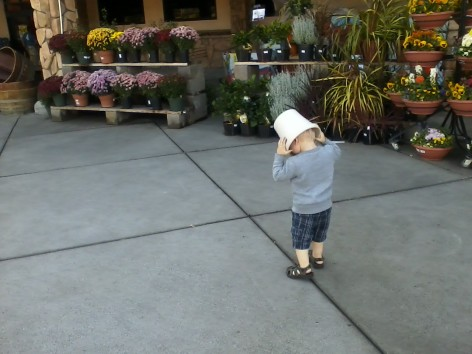 Running around Home Depot with a flower pot on his head... that's my kid!