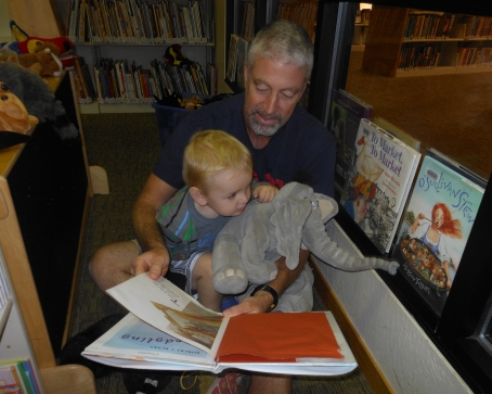 Damien, Bapa, and Horton read a story in the library