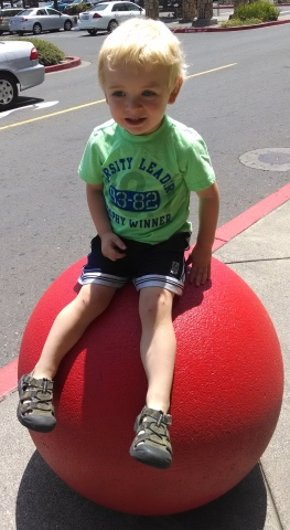 Sitting on one of those random concrete balls in front of Target