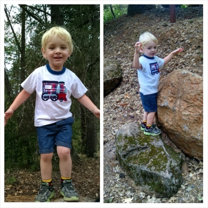 Climbing on rocks on a walk through our new neighborhood